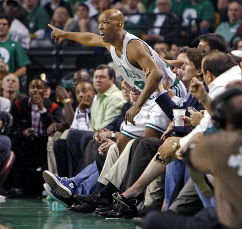 Celtics guard Sam Cassell ended up with the fans after he chased a first-half loose ball.