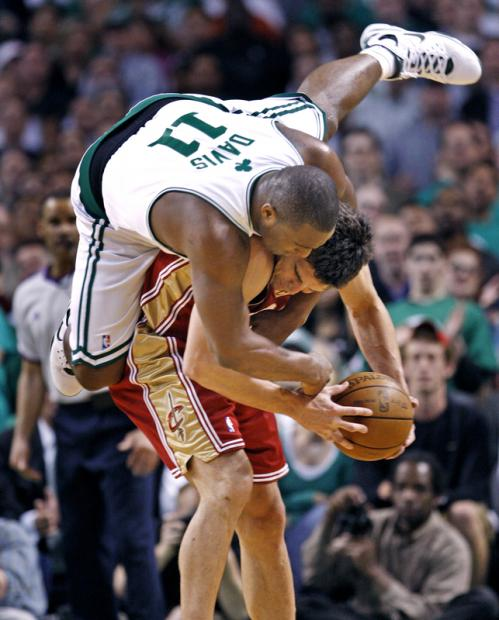 Cavaliers guard Wally Szczerbiak finds himself with an unexpected visitor as Boston's Glen Davis leaps on his back.