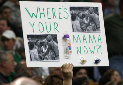 A Celtics fan holds a sign directed at LeBron James.