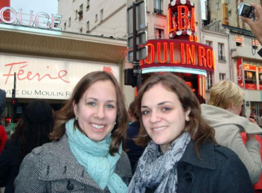 'It's an absolute myth that French people don't speak, or refuse to speak, English to you.' - Mary Ann Georgantopoulos, right, with fellow Northeastern student Julie Balise outside the Moulin Rouge.