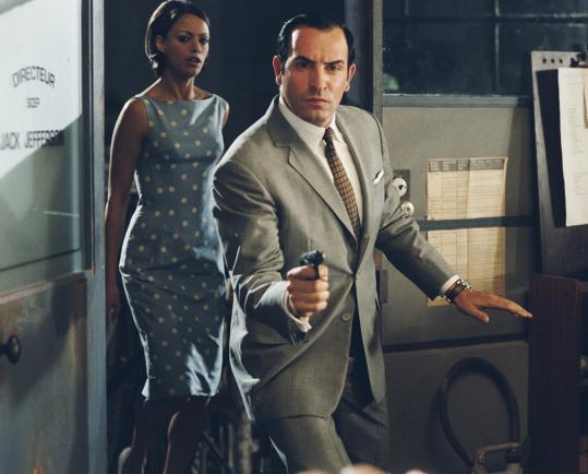 Jean Dujardin (with Bérénice Bejo) plays a superspy in 'OSS 117,' Michel Hazanavicius's espionage comedy set at the end of World War II.
