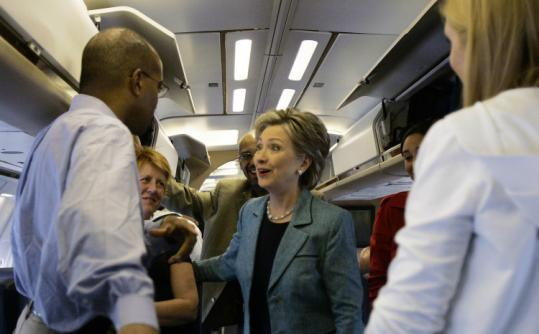 Senator Hillary Clinton (shown on her campaign plane) rapped Senator John McCain for opposing the farm bill.