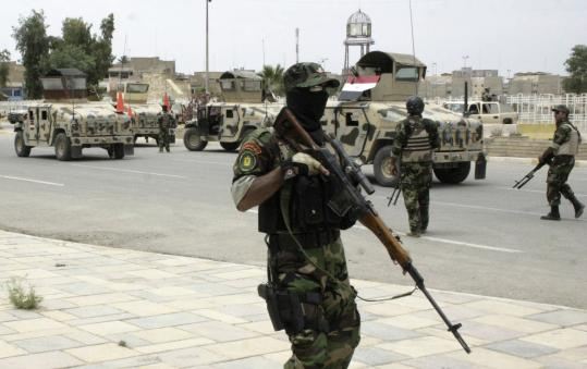 Iraqi government forces patrolled the town of Mosul yesterday. Government troops began home searches for Al Qaeda.