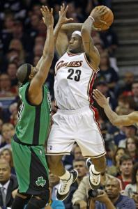 James Posey gets in LeBron James's face as the Cleveland superstar (32 points, 6 assists) looks to dish the ball.