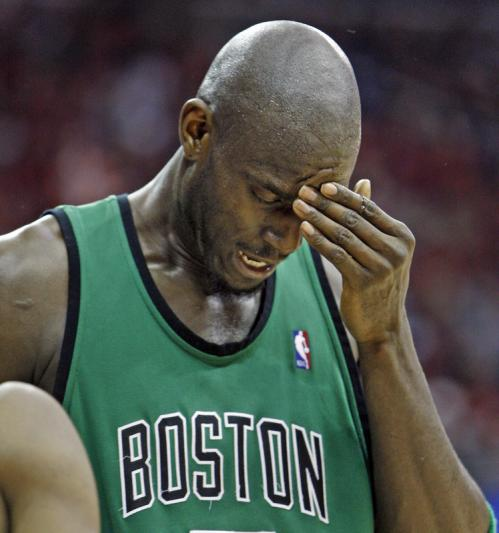 Celtics forward Kevin Garnett reacted after getting hit in the face while battling under the basket in the fourth quarter.