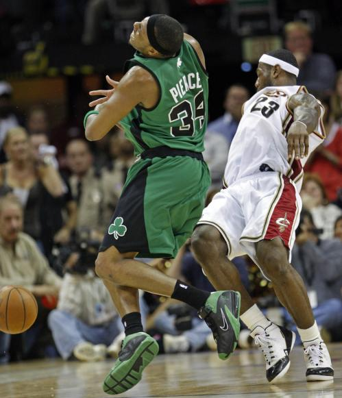 Celtics forward Paul Pierce was called for a charging foul on this controversial play late in the game, as LeBron James hits the floor.