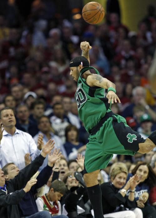 Celtics guard Eddie House had the front row fans ducking as he chased an errant fourth quarter pass.