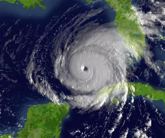 Hurricane Rita is shown just northwest of Cuba in September 2005. Warmer temperatures will reduce the number of hurricanes in the Atlantic, a new study says.