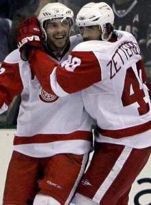 Pavel Datsyuk and Henrik Zetterberg, Detroit's dynamic duo, celebrate Datsyuk's goal that gave the Red Wings a 2-0 lead.