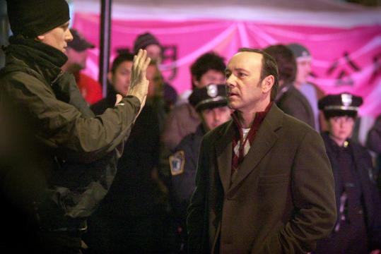 Tax subsidies are credited with drawing stars such as Kevin Spacey (right), filming '21' in Chinatown last year, to the Bay State.