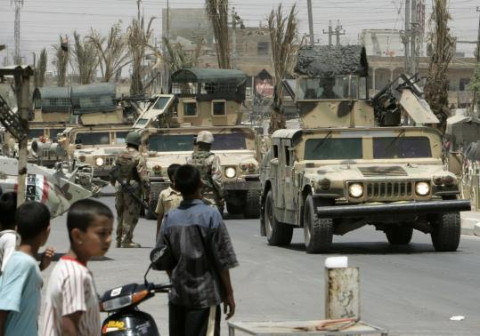 A convoy of Iraqi armored vehicles made its way into Sadr City yesterday. The Iraqi force passed burned-out shops and buildings pockmarked with bullet holes, signs of years of clashes. But many stores were open, and some residents came out to greet them