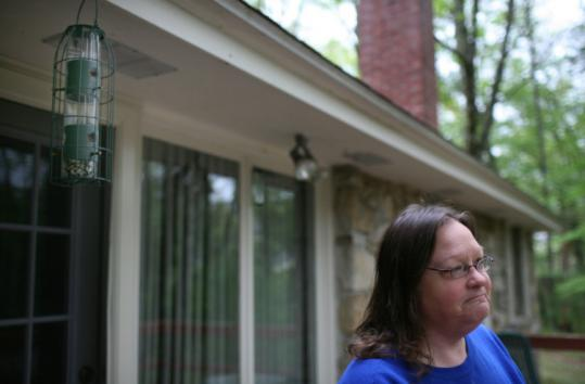 Carla Jones missed seeing the bear, but awoke to find one of the bird feeders at her Uxbridge home smashed and a few others damaged. Like some others who live in the area, she said she wasn't fearful. 'Actually, it's kind of cool,' Jones said. Nevertheless, authorities warn that residents should not approach bears.