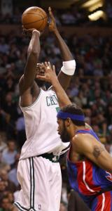 Kevin Garnett tallies 2 of his 26 points despite some in-your-face defense by Detroit's Rasheed Wallace.