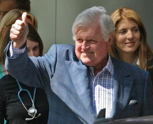 Senator Edward M. Kennedy was upbeat as he left Massachusetts General Hospital yesterday morning with family, including niece Caroline Kennedy.
