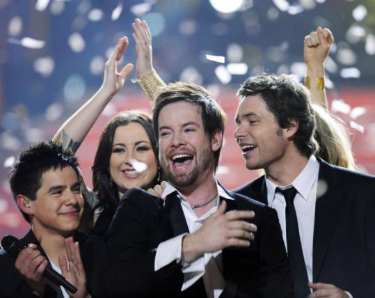 David Cook (center) is congratulated by fellow contestants David Archuleta (left) Carly Smithson, and Michael Johns afte