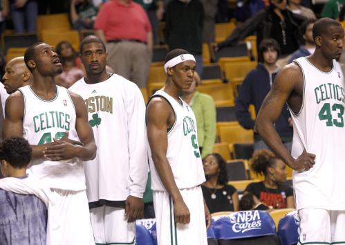 Celtics guard Rajon Rondo and the bench look on glumly as the Celtics were going down in Game 2 to Detroit.