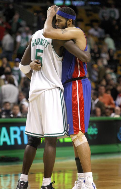 Celtics forward Kevin Garnett and Pistons forward Rasheed Wallace embrace at the end of the game.