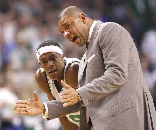 Celtics guard Rajon Rondo listens to some advice from Celtics head coach Doc Rivers in the first half.