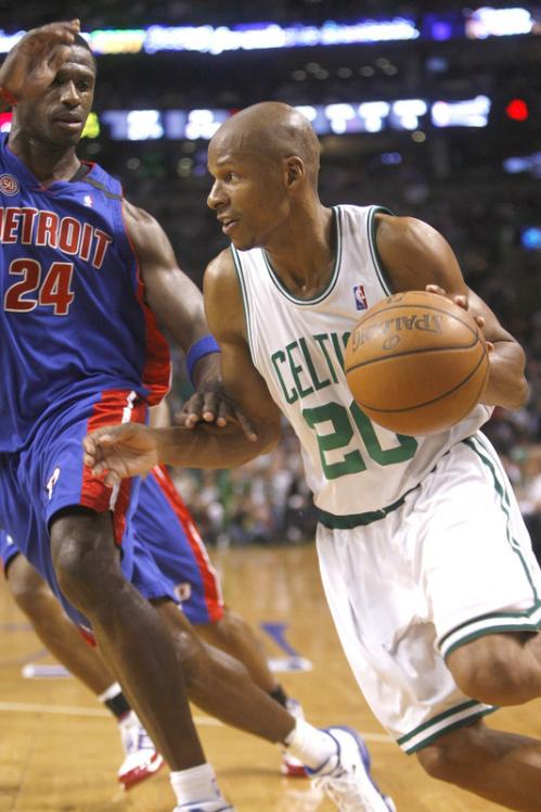 Celtics guard Ray Allen drives to the basket on Pistons forward Antonio McDyess in the first half.