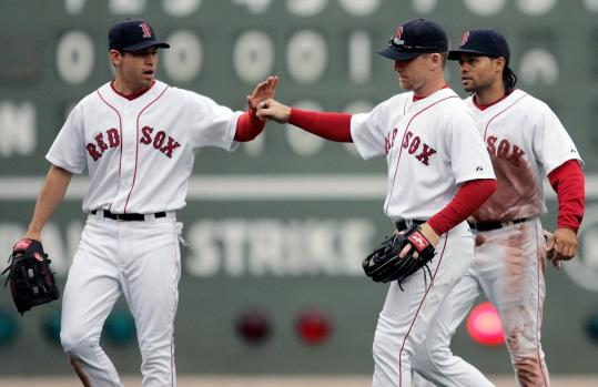The outfield trio of Jacoby Ellsbury, J.D. Drew, and Coco Crisp has been getting the job done offensively and defensively, and nobody is complaining.