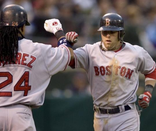 Dustin Pedroia receives kudos from Manny Ramírez after Pedroia slugged a solo home run in the fourth inning.