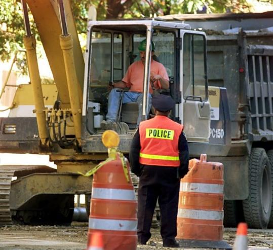 A police officer worked a construction detail on West Broadway in South Boston. Police have said they provide the best protection for the public and for road workers.