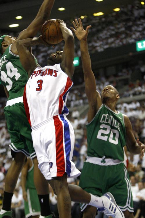 Celtics forward Paul Pierce (34) and guard Ray Allen (20) defended the lane as Pistons guard Rodney Stuckey (3) tried to penetrate in the 3rd quarter.