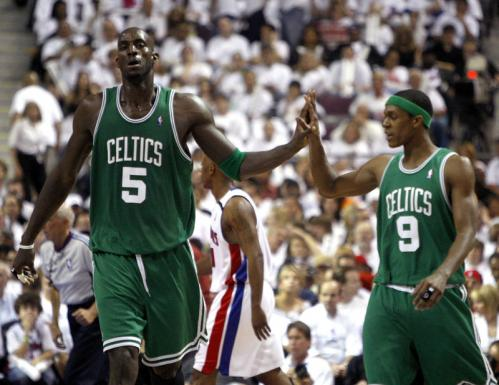 Celtics forward Kevin Garnett (5) and guard Rajon Rondo (9) high fived as they headed to the bench during a timeout late in the 2nd quarter.