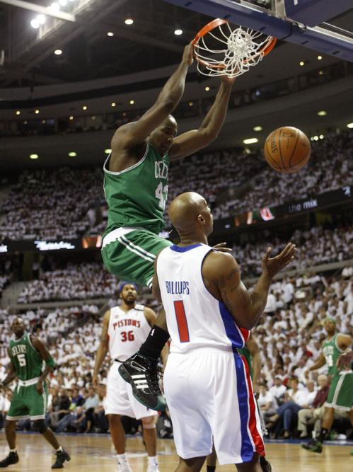 Celtics center Kendrick Perkins (43) jammed it home over Pistons center Chauncey Billups (1) in the 1st quarter.