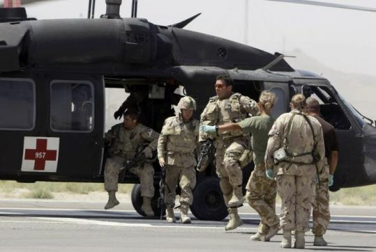 A Blackhawk helicopter brought injured Canadian soldiers to Kandahar, Afghanistan, after an attack on a NATO convoy.