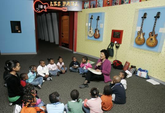 Music therapist Deforia Lane teaches children music and literacy in the Toddler Rock program at the Rock and Roll Hall of Fame.