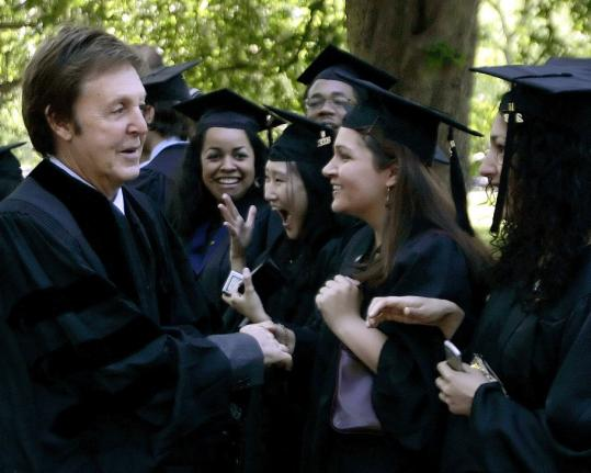Paul McCartney shakes hands with graduating seniors as he takes part in commencement ceremonies yesterday at Yale University.