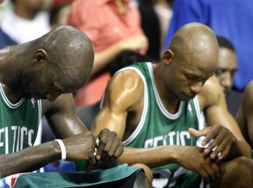 Boston Celtics forward Kevin Garnett (5) and guard Ray Allen (20) hang their heads as the Detroit Pistons emerged with a 94-75 triumph in Game 4 of the Eastern Conference finals to knot the series at 2.Stroll through our gallery to see more scenes from Sunday's loss.