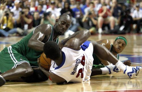 Boston Celtics forward Kevin Garnett (5) and Detroit Pistons forward Antonio McDyess (24) battle for a loose ball.