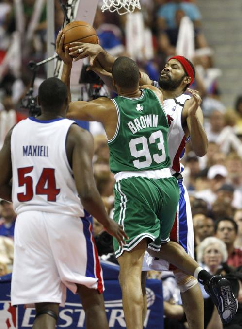 Detroit Pistons forwards Jason Maxiell (54) and Rasheed Wallace (36) defend Boston Celtics forward P.J. Brown (93).