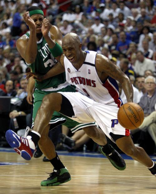 Boston Celtics forward Paul Pierce (34) is called for a foul on Detroit Pistons guard Chauncey Billups (1).