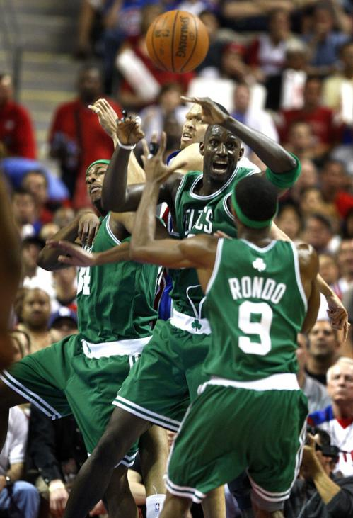 Paul Pierce (34), Kevin Garnett (5), and Rajon Rondo (9) all vie for a rebound.