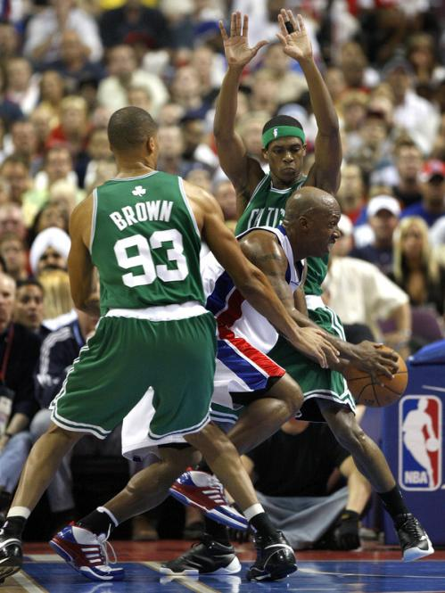 Detroit Pistons guard Chauncey Billups (1) tries to split the defense of Boston Celtics forward P.J. Brown (93) and guard Rajon Rondo (9).