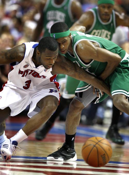 Detroit Pistons guard Rodney Stuckey (3) and Boston Celtics guard Rajon Rondo (9) battle for a loose ball.