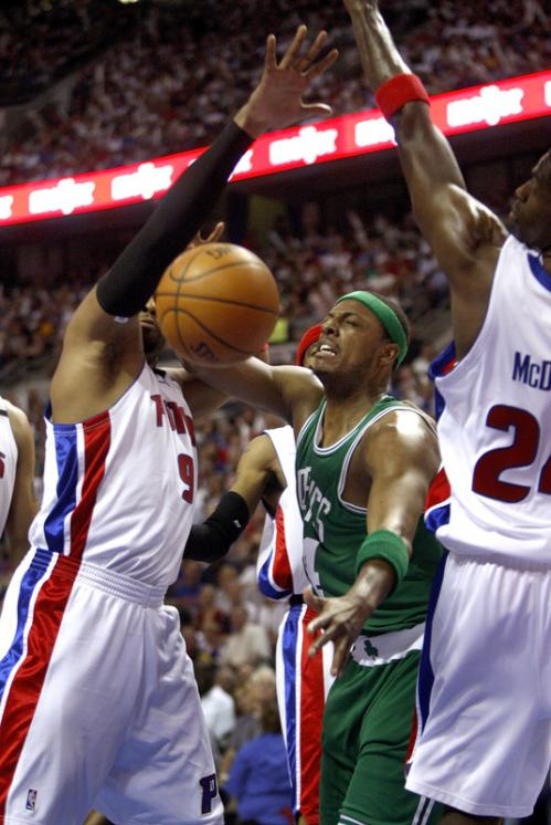 Boston Celtics forward Paul Pierce (34) loses the ball on a drive to the basket as he encounters Pistons forwards Jarvis Hayes (9) and Antonio McDyess (24).