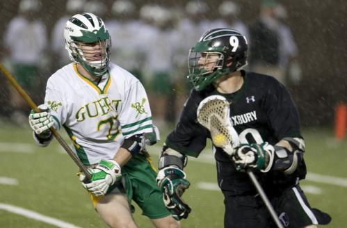 Bishop Guertin's Zach Johnson (29) defends Duxbury's Gus Quinzani. The top-ranked Dragons defeated the New Hampshire entry, 21-15, in a rain-soaked battle Friday night at Harvard Stadium. Check back Thursday for a feature on the Guertin lacrosse team in Globe NorthWest.