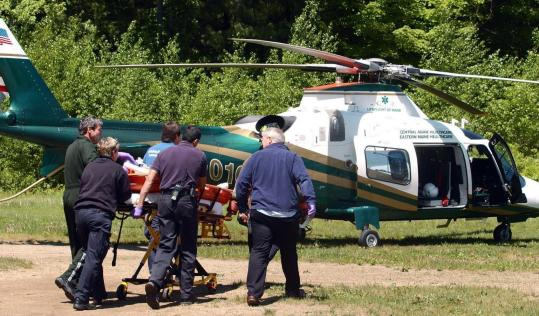 One of the victims was loaded yesterday on a LifeFlight of Maine helicopter.