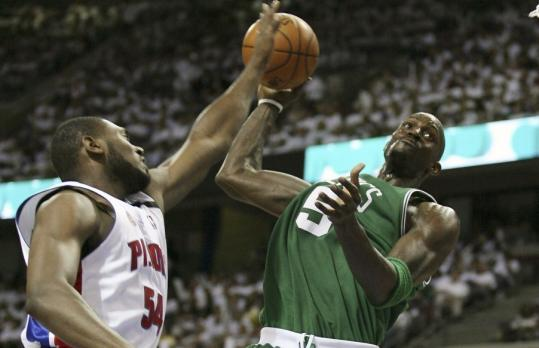 In Game 3 (above), Jason Maxiell proved to be a pest for Kevin Garnett. In Game 4, he was downright menacing as he blocked a Garnett dunk attempt.