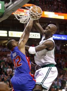Kevin Garnett scores 2 of his 33 points from close range - probably too close for the Pistons' Theo Ratliff's liking.