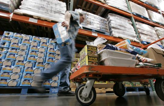 Costco Wholesale Corp. reported a 32 percent jump in fiscal third-quarter profit, topping Wall Street expectations, as cash-squeezed customers flocked to its warehouse clubs in search of bargains on food and toiletries.
