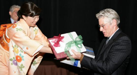 Richard Gere with Yuko Hunt at the Japan Society of Boston dinner.