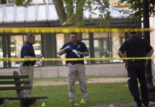 Police worked the scene of a shooting at the Boston Common. Police Superintendent Bruce Holloway said the victim had an outstanding warrant, but he did not disclose details.