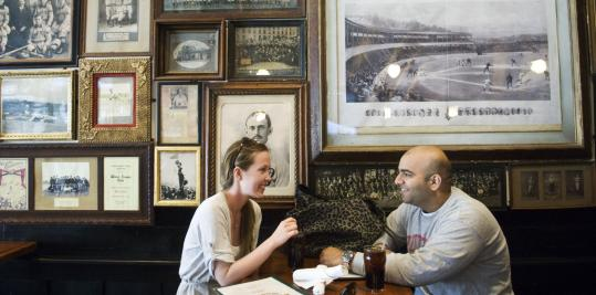 Ellie Reading and Kevinraj Bhatia enjoy a drink at McGreevy's.
