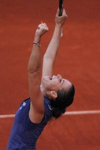 Flavia Pennetta rejoices after stunning Venus Williams to reach a rare milestone - the fourth round of the French Open.