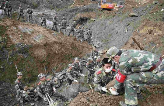 Chinese troops raced to drain a swelling earthquake-formed lake named Tangjiashan by digging a diversion channel yesterday. Tangjiashan is the largest of more than 30 lakes that have formed behind landslides caused by the May 12 quake.